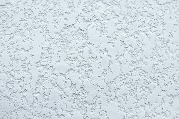 Texture of white wall with plaster pattern. Textured backdrop, design repair, bas-relief.