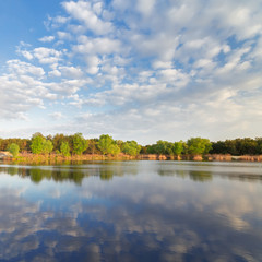 Foto op Canvas Bos rivier autumn lake, fluffy clouds / calm water landscape clouds reflected in the water