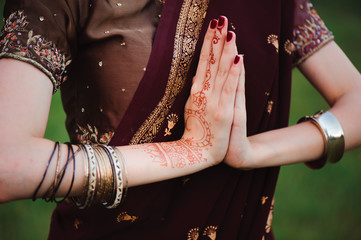 Mehndi covers hands of Indian woman