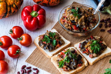 Vegetarian food. stewed vegetables on bread and in a plate. saute from eggplant.