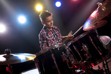 teenage boy behind drum kit