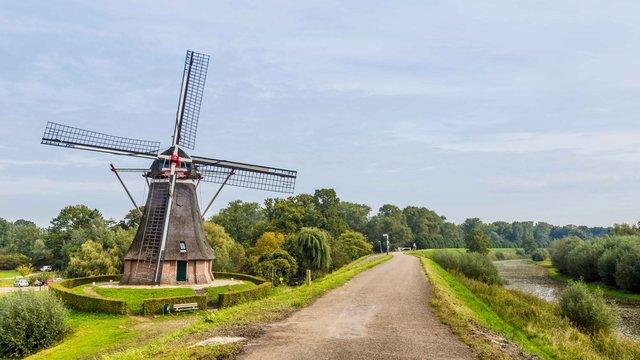 Dutch windmill on a dike