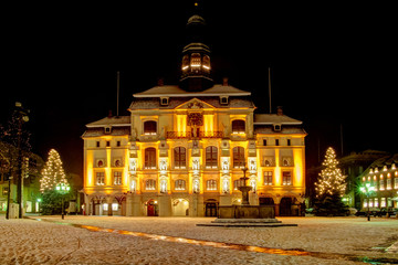 Lüneburg (near Hamburg) Germany: Old famous Townhall with christmas Trees and snow.