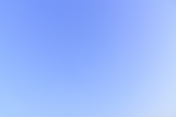 The blue sky background with white, purple, orange and yellow gradient in the morning.