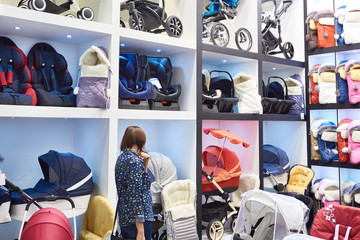 Buyer in the store of baby carriages