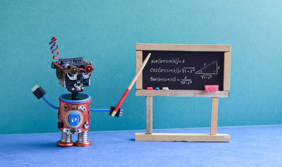Math lesson in college. Robot teacher explains theory inverse trigonometric functions. Classroom interior with handwritten formula black chalkboard. Blue green colorful background.