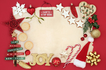 Christmas background border with bauble decorations, signs, mince pies, gingerbread cookies, holly, mistletoe and fir on parchment paper on red.