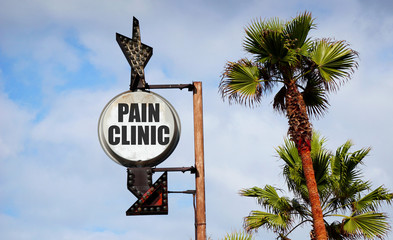 pain clinic sign with palm trees