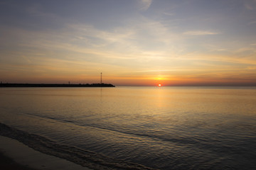 Sunset over sea on a beach in Klaipeda, Baltic Sea, Lithuania