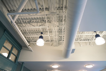 Foto op Aluminium Industrial geb. Close up on light and pipes on the ceiling interior