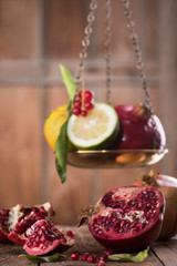 Raw Red Pomegranate With Seeds On Table