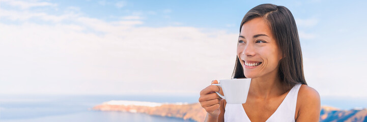 Wall Mural - Woman drinking coffee at morning breakfast banner. Happy Asian girl holding cup of tea looking at holiday sea view with sky background. Panoramic crop.