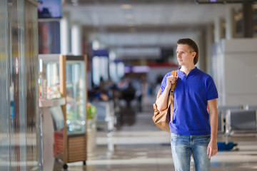 Young man in an airport indoor