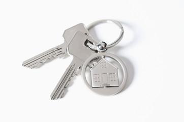 House key on a house shaped pendant