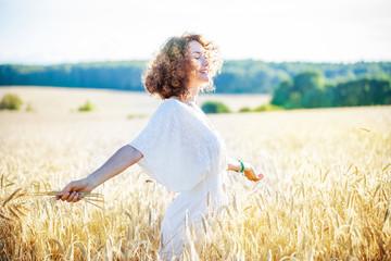 smiling happy woman in wheat field