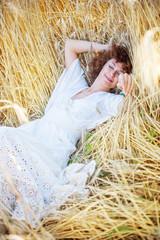 happy sleeping woman in wheat field