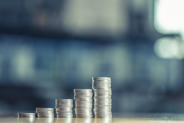 Stacks of coins on working table, finance and business concept, shallow focus.