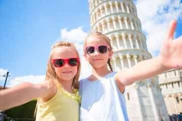 Little kids taking selfie background the Leaning Tower in Pisa, Italy. Photo about european vacation