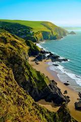 Looking along coastline towards Llangrannog village and beach in Pembrokeshire, Wales, UK