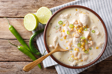 White chili chicken with beans, corn and spices. horizontal top view