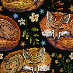 Embroidery sleeping fox and flowers seamless pattern. Fashionable template for design of clothes. Classical embroidery seamless background. Red fox sleeping in flowers