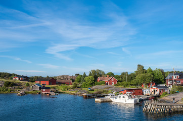 Nötö island during the daytime pier and colourful red wooden houses