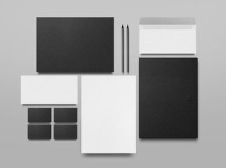 Mock up. Set of mock up elements on gray background. Blank objects for placing your design. Black folder, a sheet of paper, an envelope, a black business card and pencils.