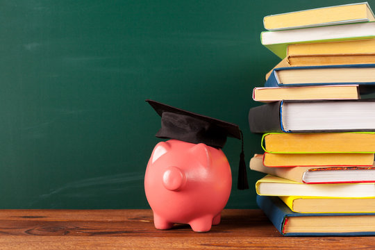 Study theme with pink piggy bank with chalkboard