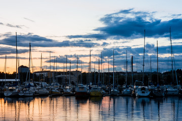 Sail boat near the pier under colourful sky in Kotka Finland