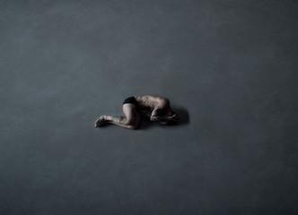 Man on a concrete floor