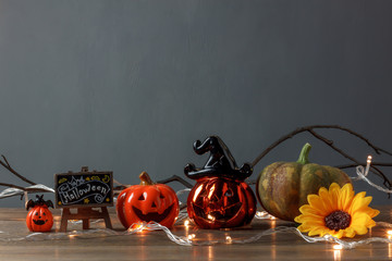 Accessory of Happy Halloween Festival concept.Essential decorations on the modern brown wooden home office desk background and copy space.pumpkins and mix several sign objects prepare for the season.