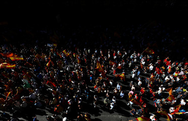 A pro-union demonstration organised by the Catalan Civil Society organisation makes its way through the streets of Barcelona