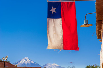 View o flag of Chile and volcano Licancabur by San pedro de Atacama
