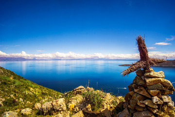 View on Lake Titicaca and cross from isla de Sol in Bolivia