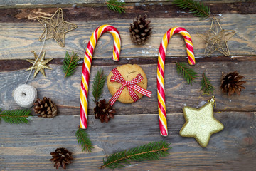 Christmas backgrounds. Christmas toys, Christmas candies on a wooden background top view