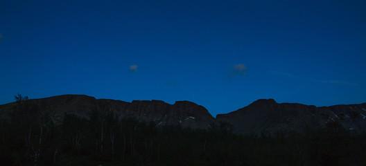 Night sky with stars over the mountains of Khibiny, Kola Peninsula, Russia.