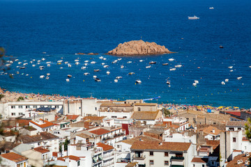 View of the town of Tossa de mar, city on the Costa Brava. Buildings and hotels by the beachl. Amazing city in Girona, sea and moored boats in Catalonia.