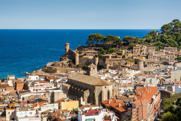 Top view of the town and castle in Tossa de mar, city on the Costa Brava. Buildings and hotels by the beach. Amazing city in Girona, sea and moored boats in Catalonia. City and see.