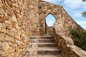 Stairs to the Castell d'en Plaja on the Costa Brava in Lloret de Mar, Spain. View of the Balearic Sea and the rocky coast. Popular tourist destination in Spain.