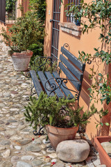 Canvas Prints Narrow alley Bench on the street in the old town in Italy