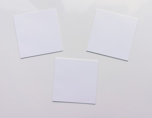 Three square sheet on a white background. Top view. Close-up