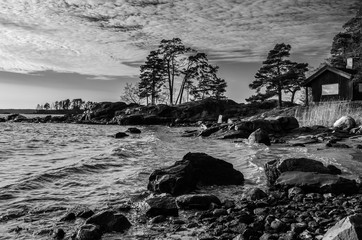 Shore of the baltic sea and the wooden cottage captured at Vuosaari area in Helsinki Finland