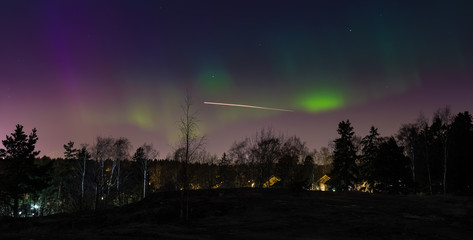 Aurora borealis above the Nordic forest captured in Helsinki Finlnad