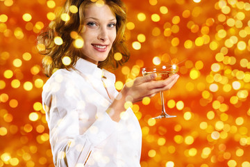 christmas theme, smiling woman toast to the new year with glass of wine