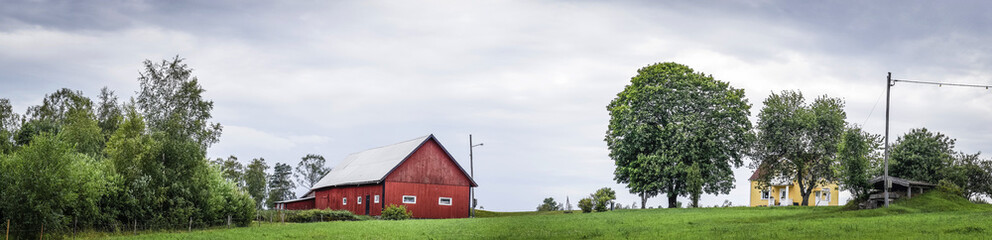 Classic red barn on a green field