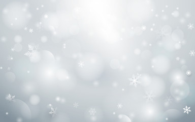 Abstract  bokeh and snowflakes in white background. Merry christmas concept