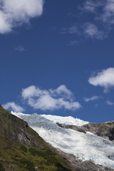 glacier with clouds and blue sky