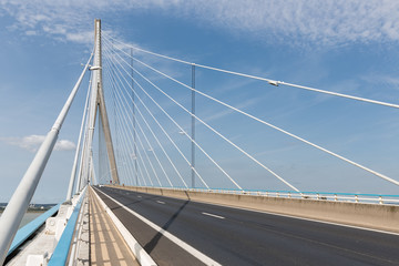 Highway with footpath at Pont de Normandie, French bridge over river Seine near Le Havre and Honfleur