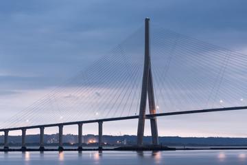 In de dag Brug Sunrise view at Pont de Normandie, bridge over river Seine between Le Havre and Honfleur in France