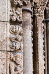 Romanesque details of the facade in the old cathedral of Plasencia. Spain.